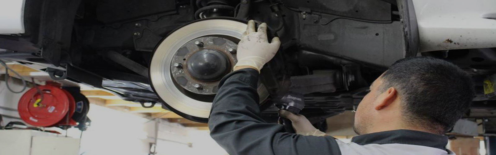 Technician servicing brakes
